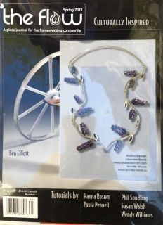 The Communal Garden lavender glass bead necklace in The Flow a glass magazine